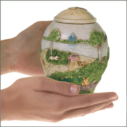rainbow bridge pet urn shown in hands for size relation