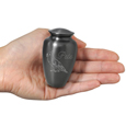 engraved simple grey urn keepsake shown in hand for size scale