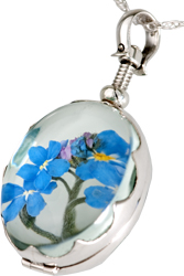 pet urn jewelry victorian oval scalloped locket shown with dried flowers