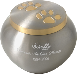 golden pawprints pet cremation urn shown with script engraving