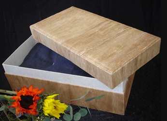 biodegradable pet casket with wood grain pattern shown with open lid
