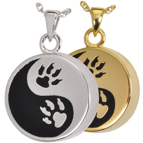 Paw-Print Yin Yang Pet Cremation Jewelry shown in silver and gold