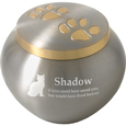 golden pair of paw prints pet urn shown engraved