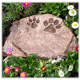 brown urn memorial stone with paw prints