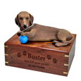 Wood engraving shown on front of red Dachshund Dog Figurine Wooden Urn