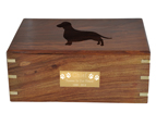 Small engraved plaque shown on front of wood pet urn