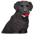 Detail of chocolate labrador figurine with ball in mouth