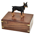 Urn shown with Miniature Pinscher dog figure only; no plaque or engraving
