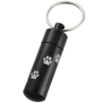 Black pet urn keepsake keychain shown with trail of engraved pawprints