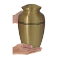 Golden Classic Cremation Pet Urn shown in hands for size scale