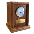 wood cremation urn shown with round picture frame and plaque