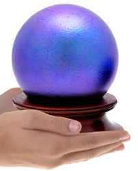 final fetch purple glass sphere cremation urn shown in hands for size scale