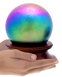 final fetch rainbow glass sphere cremation urn shown in hands for size scale