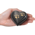 Pet Urn Keepsake: Gun Metal Heart with Brass P shown in hand for size scale