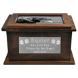 Large plaque and b&w photo shown with wood pet urn