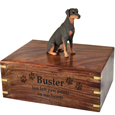 Wood engraving shown on front of Doberman Pinscher Red Sitting figurine urn