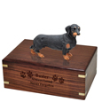 Wood engraving shown on front of Dachshund Black Figurine Wood Urn