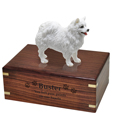 Wood engraving shown on front of American Eskimo Figurine Wood Urn